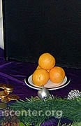 St. Nicholas symbols: gold coins and oranges with the saint's image