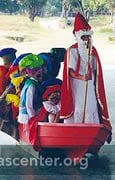 School assembly where children show Dutch culture in Sinterklaas traditions