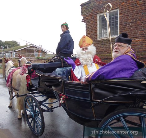 St Nicholas comes in procession to the church, with village priest