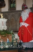 St. Nicholas pays homage to the Crib