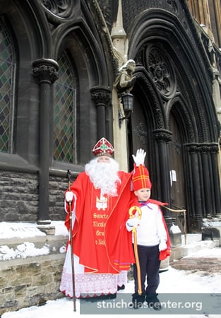 Greeting parishioners with the Boy Bishop