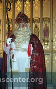 St Nicholas stands in front of the statue of St Nicholas in St Peter's reredos