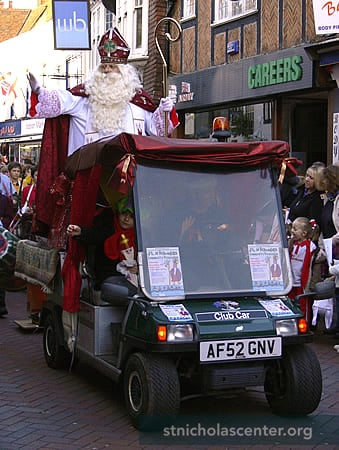 St Nicholas rides through the busy shopping district