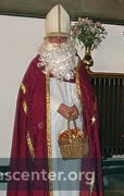 St Nicholas with basket of gold coins to distribute
