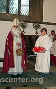 St Nicholas with one of his helpers