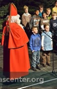 Left: Primary children offer songs and poems to the program<br />The Saint with one of the traditional Nikolaus breads