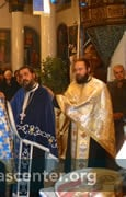 "12 priests and a deacon joined the bishop to bless the artoklasia<br />Photos: Gregory Edwards <a href=""http://edwardsingreece.blogspot.com/2013/01/feast-of-st-nicholas-portaria.html"" target=""new"" class=""link"">Edwards in Greece</a>"