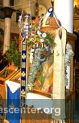 "St. Nicholas icon decorated for the feast day<br />Photos: Gregory Edwards <a href=""http://edwardsingreece.blogspot.com/2013/01/feast-of-st-nicholas-portaria.html"" target=""new"" class=""link"">Edwards in Greece</a>"