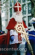 Sinterklaas rides a white horse through the streets