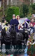 Sinterklaas arrives in a horse drawn carriage
