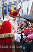 Sint greets children lining the streets