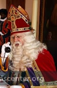 At the castle, Sint greets visitors and takes calls
