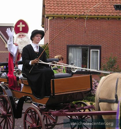 Sinterklaas arrives in wagon, pulled by a horse