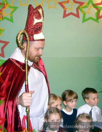 Saint Nicholas greets children and tells his story
