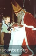 When Samichlaus visits children at home between 29 November and 7 December, he talks with them about their behavior and the children say a poem before receiving treats of cookies and small toys