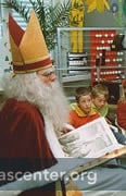 Samichlaus visits school classrooms