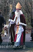 Samichlaus arrives in the forest with Schmutzlis and a donkey in mid-November