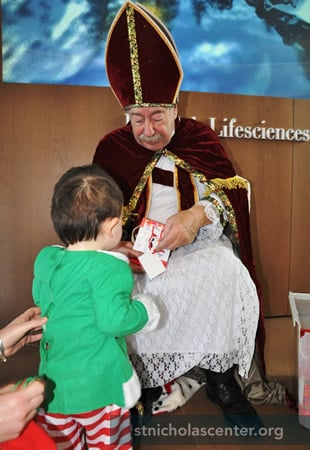 St. Nicholas gives treats to each child