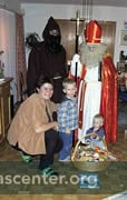 Saint Nikolaus visits children in homes (donations fund gifts for those in need)
