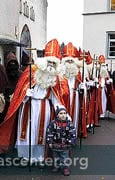 Children recite Nikolaus poems when the Nikolauses come out of the church