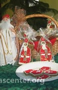 "Each child is given two <a href=""/pages/cookies/"" target=""new"" class=""link"">cookies</a>—a miter to eat and a bishop St. Nicholas to take home"