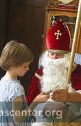 St Nicholas gives each child one of his special cookies