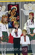 Children perform and sing as part of the celebration
