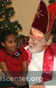 St. Nicholas talks with each child