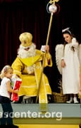 Saint Nicholas has gifts for all the children, while some shepherds watch