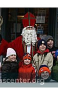 St. Nicholas with children in town