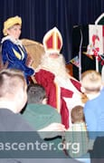 Sinterklaas waits with the children for the program to begin