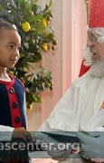 Sint Niklaas gives gift bags to children