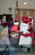 Sinterklaas talking with children