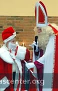 St. Nicholas engaging a student to show differences and similarities between St. Nicholas and Santa Claus