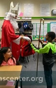 St. Nicholas gives a gift bag to each child