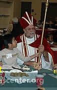 St. Nicholas talks with children during the breakfast