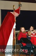 St. Nicholas goes from table to table