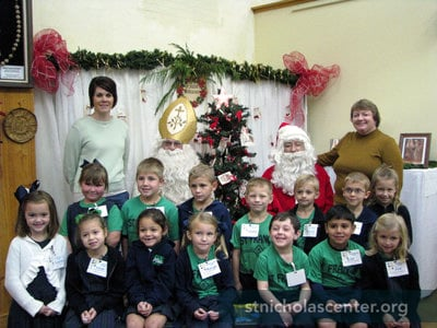 St. Nicholas and Santa pose with each class