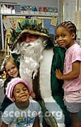 "St. Nicholas talks with all the children and gives each a ""kindness coin"""
