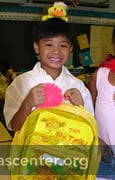 Backpacks filled with books and toys for each child