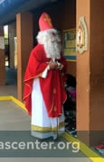 Saint Nicholas preparing to fill shoes