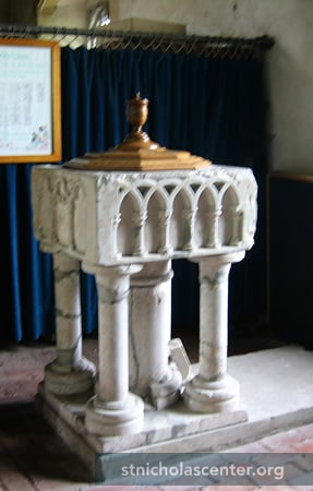 Early 1300s font, originally from St Marys, Shopland, demolished in 1957 after World War II damage; cover is from a more modern font