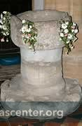 Saxon font, ca 970, there is also a 15th century stone font