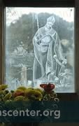 The Millennium St Nicholas window depicts 3 boys from the legend of the tub, they hold bags of gold from the dowry story, ship and sailors, and herbs, lavender, and rose for perfuners