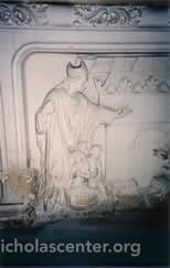 Relief stone carving with children in tub