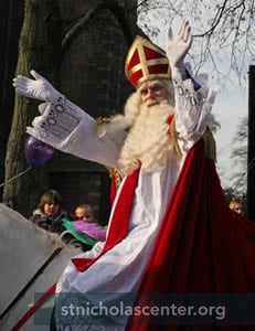 Sinterklaas waving on horse