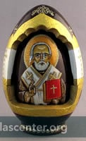 Wood egg with opening showing inner egg with icon image