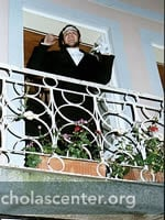 Town crier on balcony