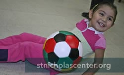 Girl with bright soccer ball