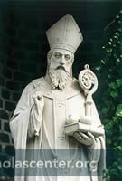 St Nicholas with good, crozier, three gold balls, crozier, in front of bricks and leaves